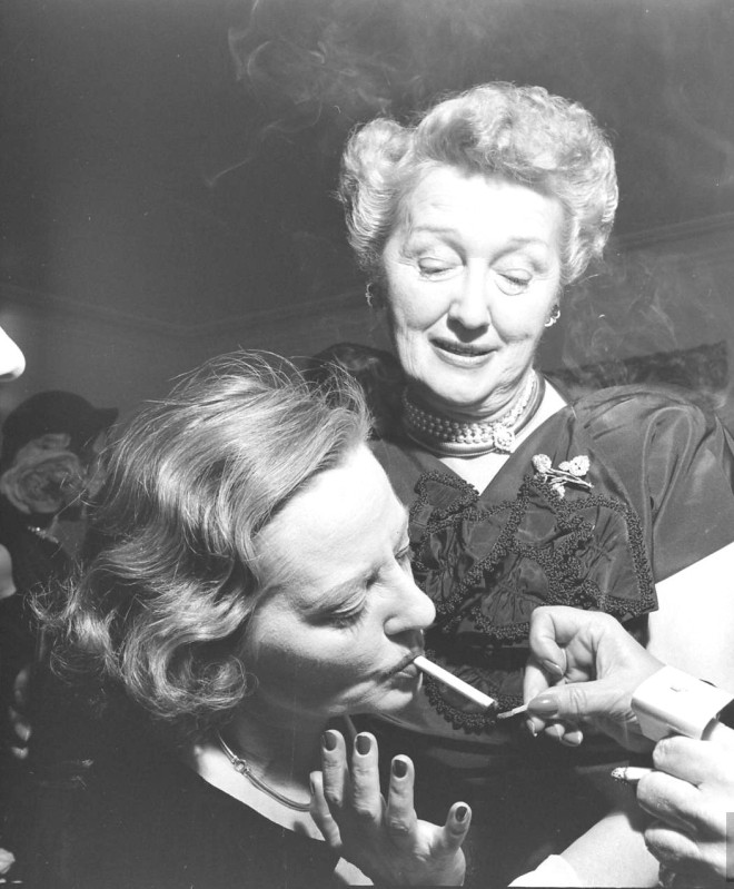 Hedda Hopper and Tallulah Bankhead drunkenly enjoy a party thrown for Bankhead, 1950 by Edward Clark. -3