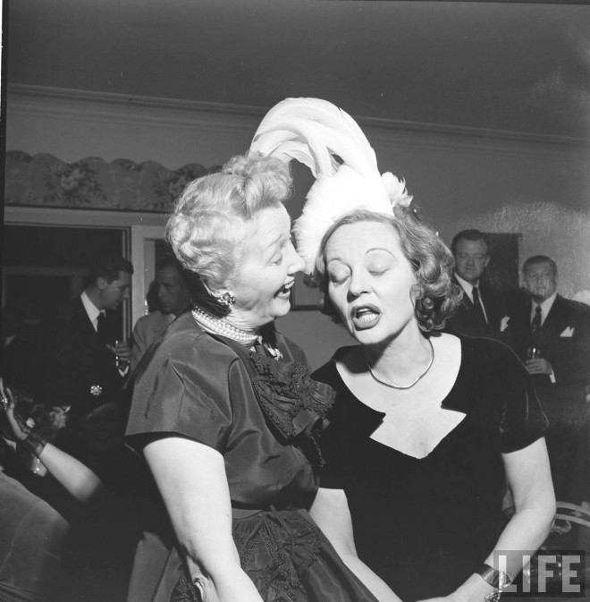 Hedda Hopper and Tallulah Bankhead drunkenly enjoy a party thrown for Bankhead, 1950 by Edward Clark. -4