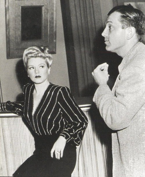 Claire Trevor listening intently to director Edward Dmytryk on the set of Murder, My Sweet.jpg