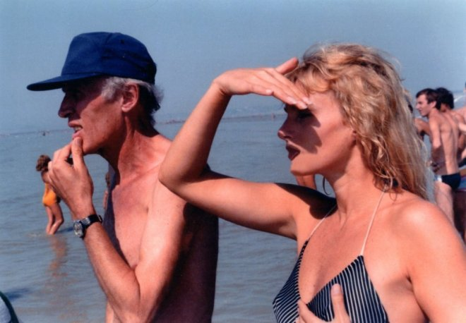 9_Director Éric Rohmer and Arielle Dombasle on location during the making of Pauline at the Beach..jpg