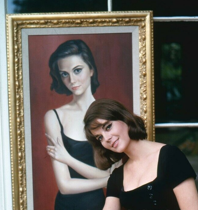 Natalie Wood posing with her portrait by Margaret Keane in 1964. Photo by Peter Basch..jpeg